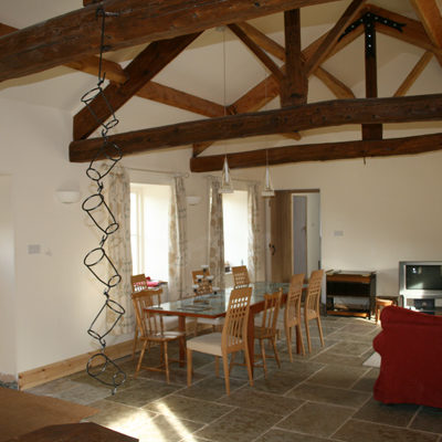 Interior of barn – refurbished oak trusses and underfloor heating to insulated stone floor